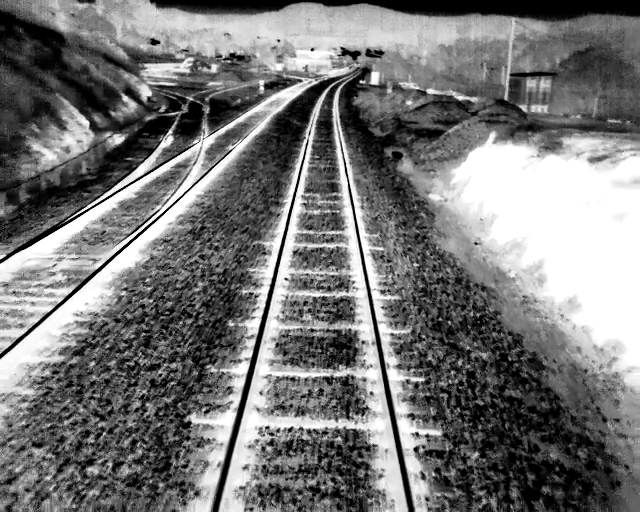 An infrared view of a railway track